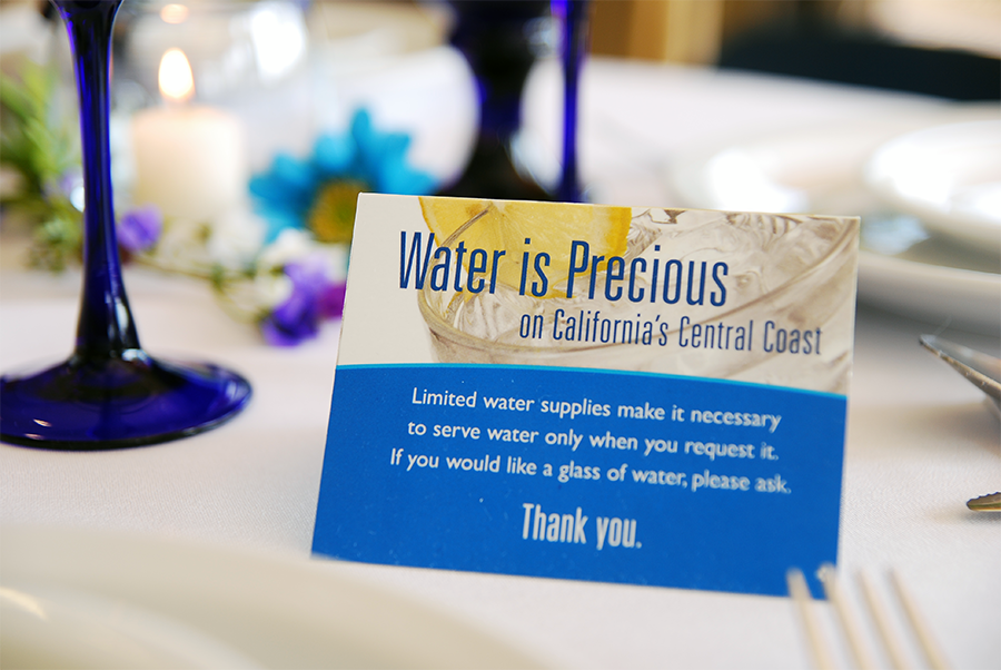 Table-tent placard reminding customers to ask for water